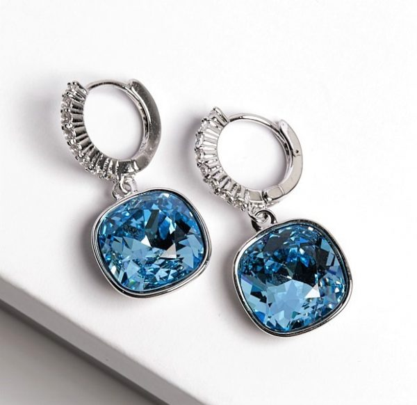 Callel Huggie Earrings Embellished with Blue Crystal from Swarovski