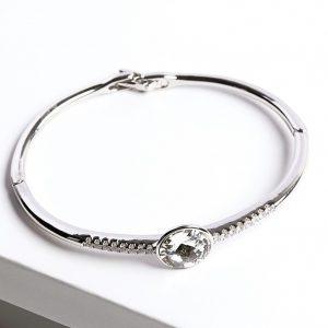 Silver Bangle Bracelet Embellished With White Crystal From Swarovski