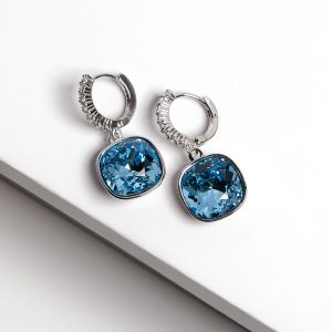 Silver Huggie Earrings Embellished With Blue Crystal From Swarovski