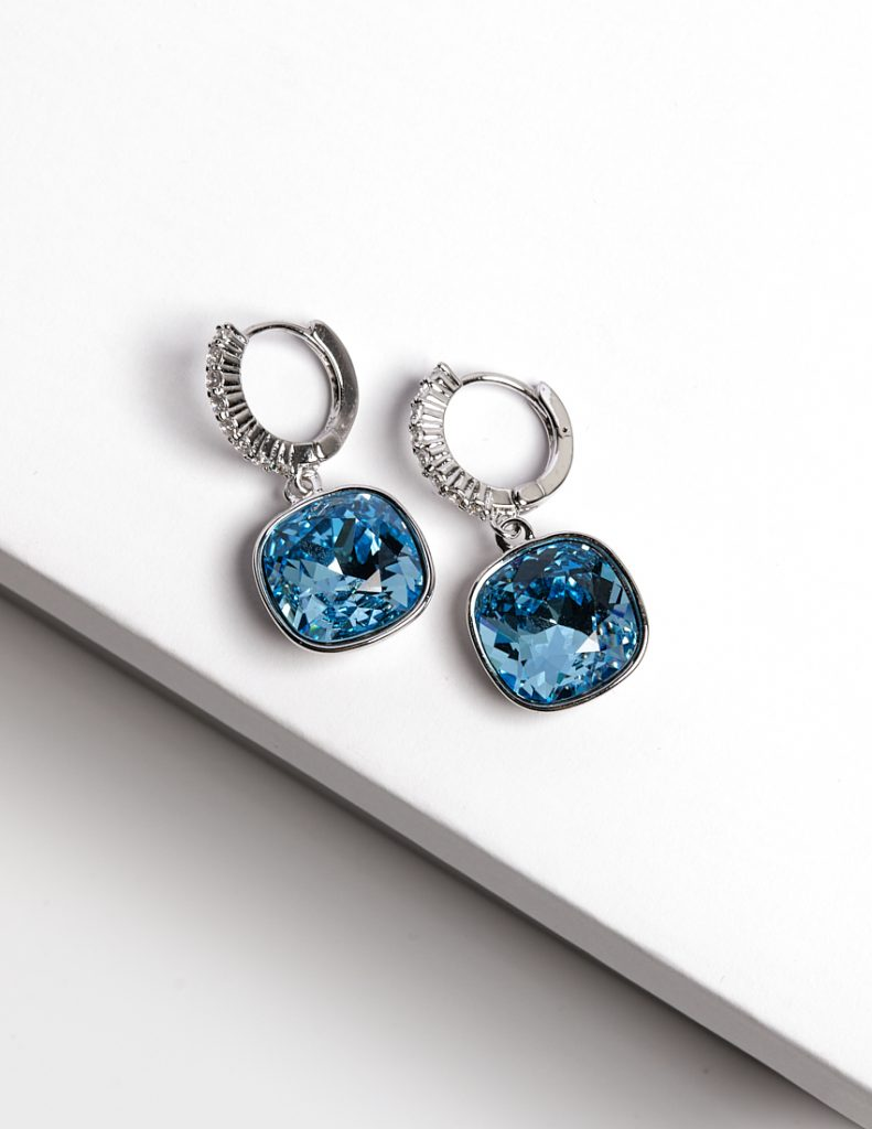 Callel Huggie Earrings Embellished with Blue Crystal from Swarovski