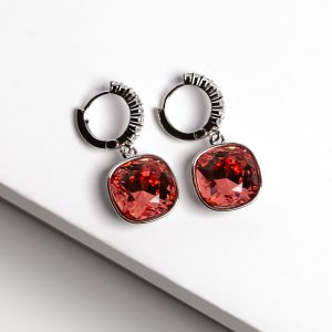 Silver Huggie Earrings Embellished With Red Crystal From Swarovski