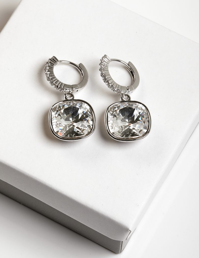 Silver Huggie Drop Earrings Embellished with White Crystal from Swarovski