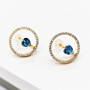 Gold Stud Earrings Embellished With Light Blue Crystal From Swarovski