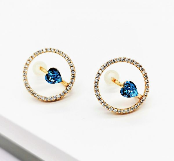 Callel Gold Stud Earrings Embellished With Light Blue Crystal From Swarovski