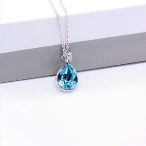 Teardrop Pendant Necklace Embellished With Light Blue Crystal From Swarovski